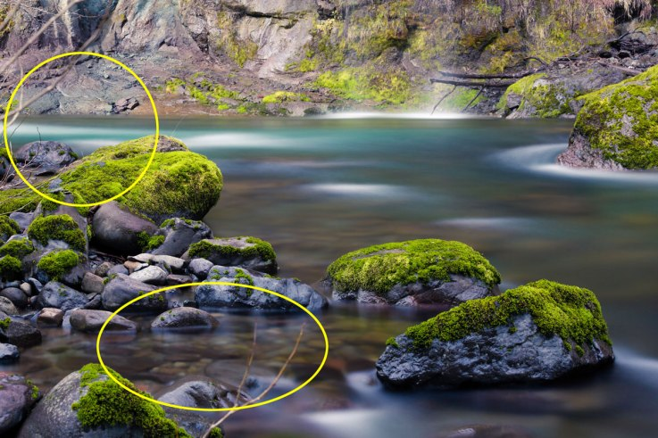 There were sticks showing in one of my earlier compositions (C), and I didn't like the way that the two rocks in the foreground were overlapping in the frame (D).