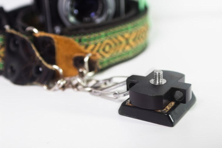SteadSnap attaches firmly between the camera and the tripod quick-release plate.