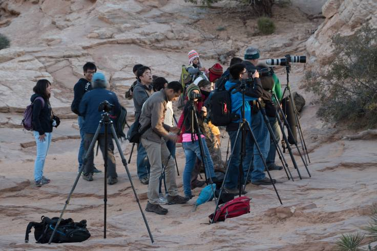 A typical, if not light, crowd of photographers and other tourists hoping to capture their own version of a Mesa Arch sunrise