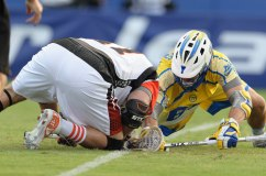 #65 Chris Mattes Midfield Florida Launch face off against #47 Anthony Kelly Midfield Denver Outlaws