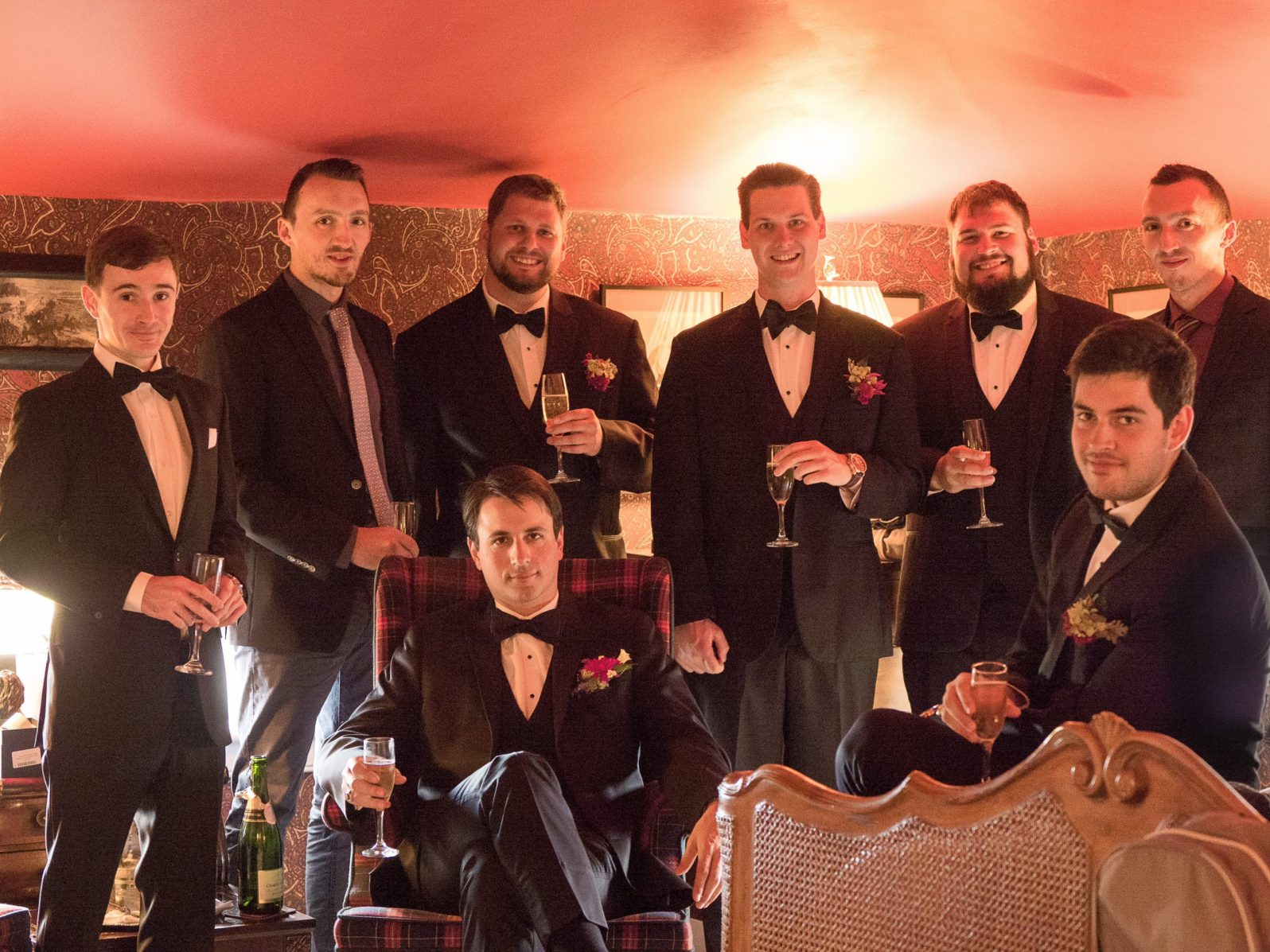 Lumix GH4, Leica 42.5mm f/1.2 lens, f/2.8, 1/30s, ISO 3200. This picture is really noisy, but it was really dark in the room, and I didn't have a lot of options for making a group portrait of the groom and his best friends. A sharp picture with noise is always better than a blurry picture without noise.