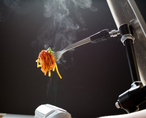 Adding steam to the pasta with a clothes steamer.