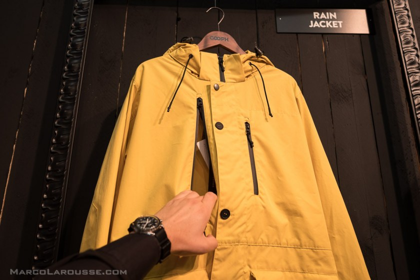 A rain jacket with an extra zimmer to pull out your camera only when you want to take a shot.