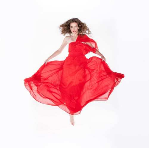 Amy in the red dress floats above the studio floor. Photo by Kevin Ames