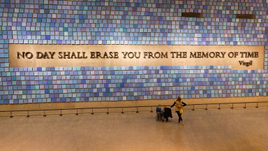 """""""No day shall erase you from the memory of time"""" is a quote by Virgil that adorns a wall in the 911 Memorial Museum"""