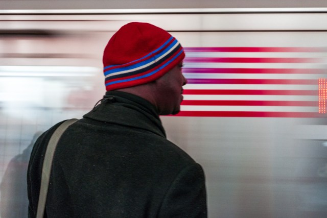 Watching a subway car streak by.