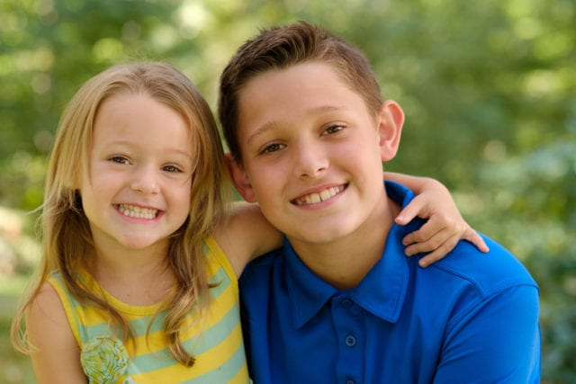 Smiling young boy and girl