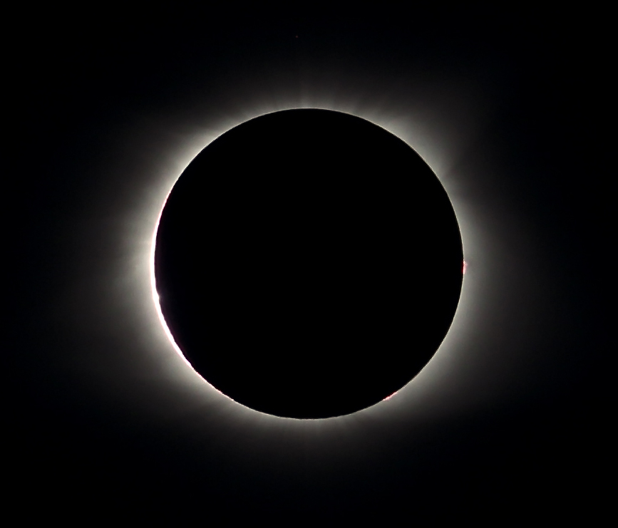 Totality! Note the solar flares on the right side of the sun/moon. An eclipse reveals the sun's corona, which in turn reveals the solar flares, and light's play within the valleys and mountains of the moon. Steven Inglima_08-21-17__SI_5716.2 crop 2