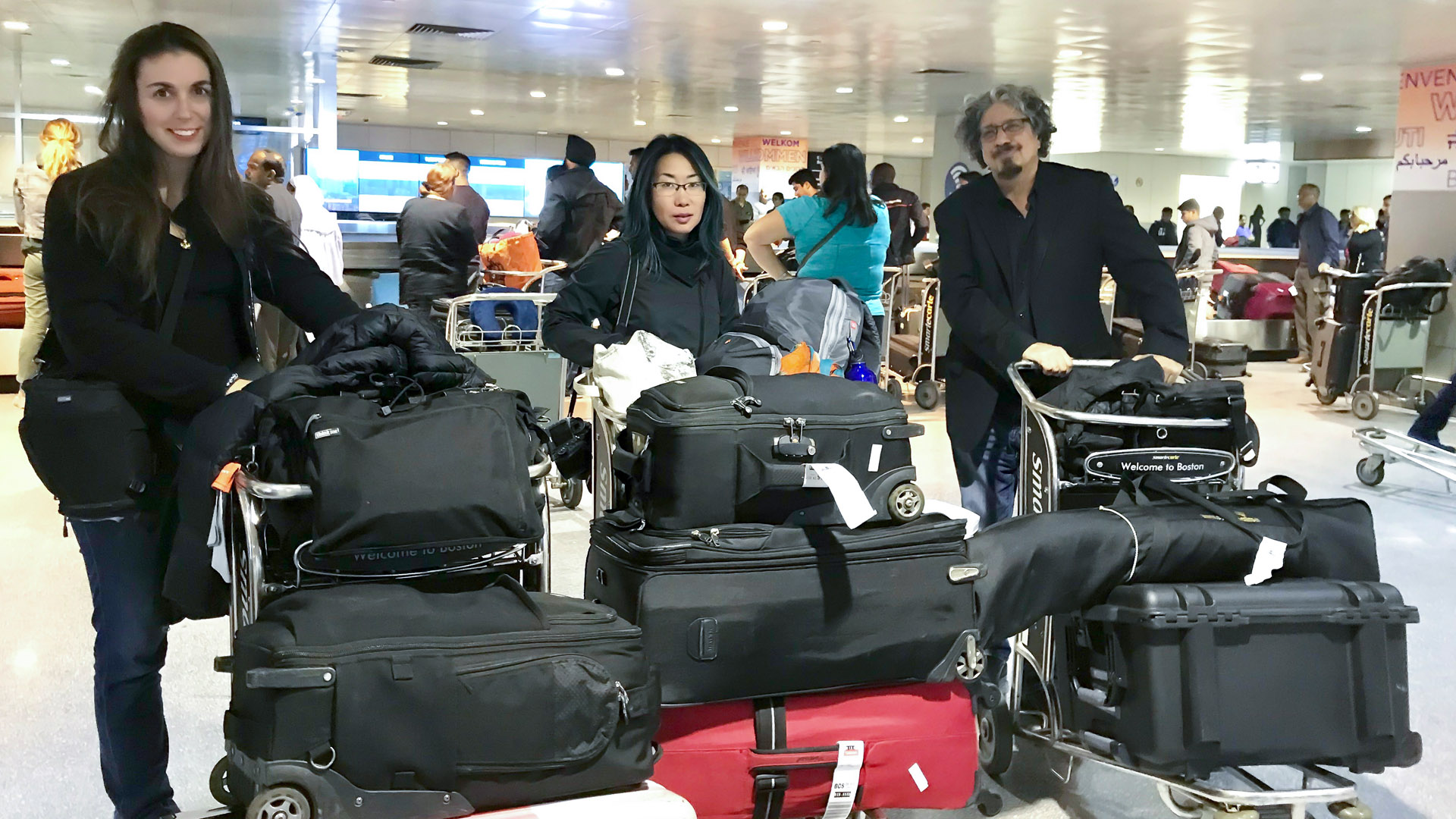 Carin, Keiko and Rick at the airport with lots of baggage.