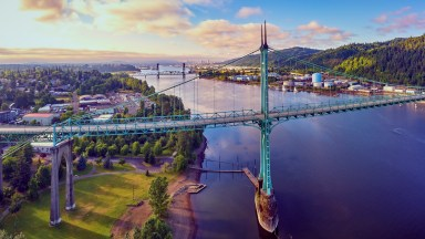 Sunrise over St Johns Bridge and Cathedral Park on a sunny summer morning