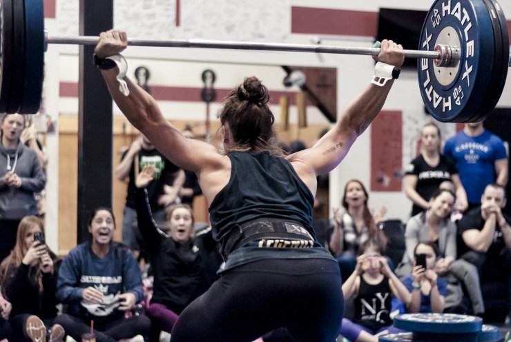 CrossFit athlete lifts snatch