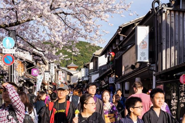 Crowded streets during cherry blossom season in Kyoto near Kiyomizu-dera Temple