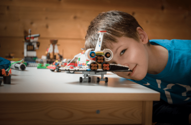 boy, potrait, plane, lego, engineer, natural light