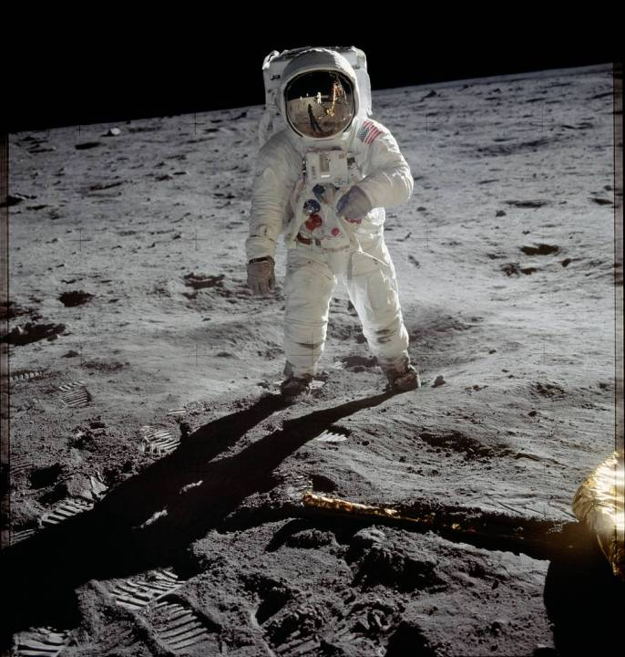 Neil Armstrong is reflected in Buzz Aldrin's space helmet on the surface of the moon in July of 1969.