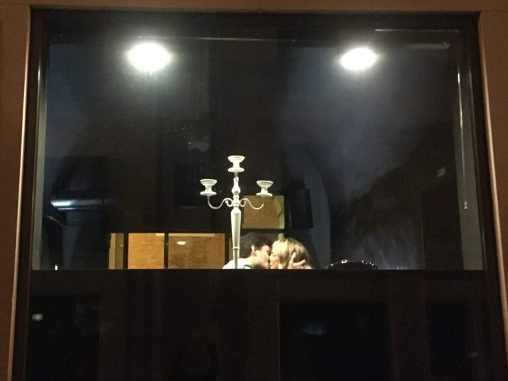 couple, night shot, kiss, window, chandelier,
