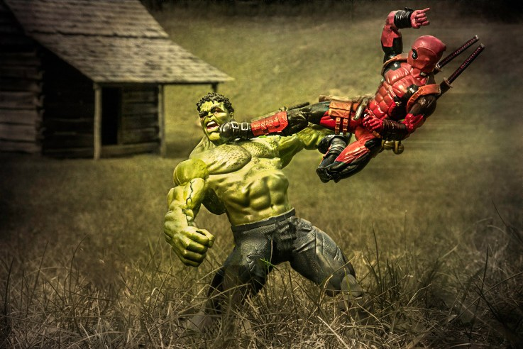 The Hulk takes a flying kick from Deadpool in front of a real life cabin.