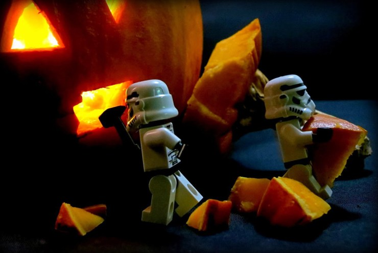 Storm troopers with pumpkin.
