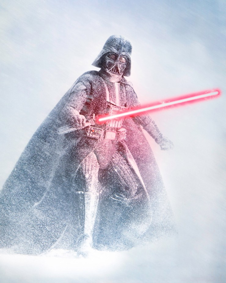 Darth Vader with light sabre in a snow storm. Toy photography at its best.