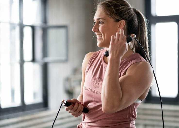 Smiling female athlete correctly exposed
