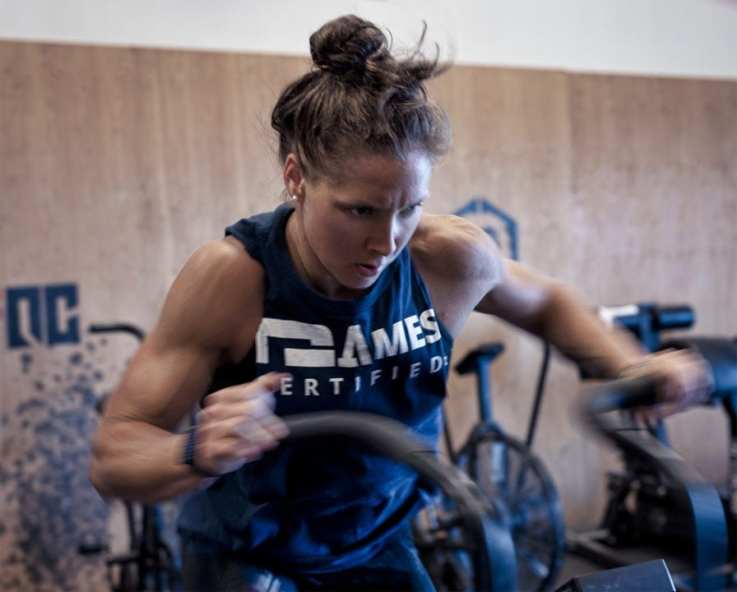 Four-time CrossFit Games athete Carol-Ann Reason-Thibault does assault bike intervals