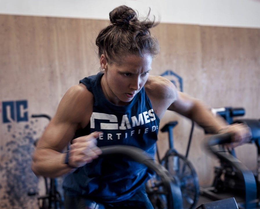 Four-time CrossFit Games athete Carol-Ann Reason-Thibault does assault bike intervals