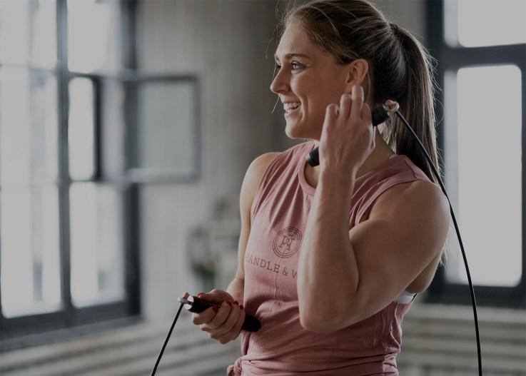 Smiling female athlete underexposed