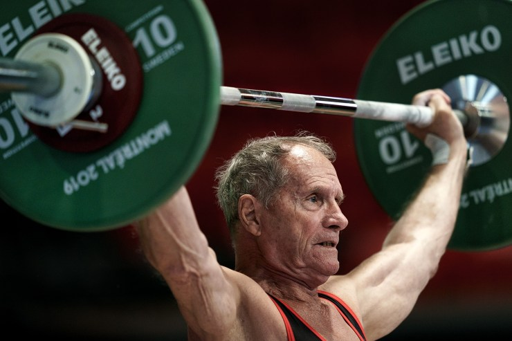 85 year-old male international olympic weightlifting athlete overhear snatch Marcel Perron