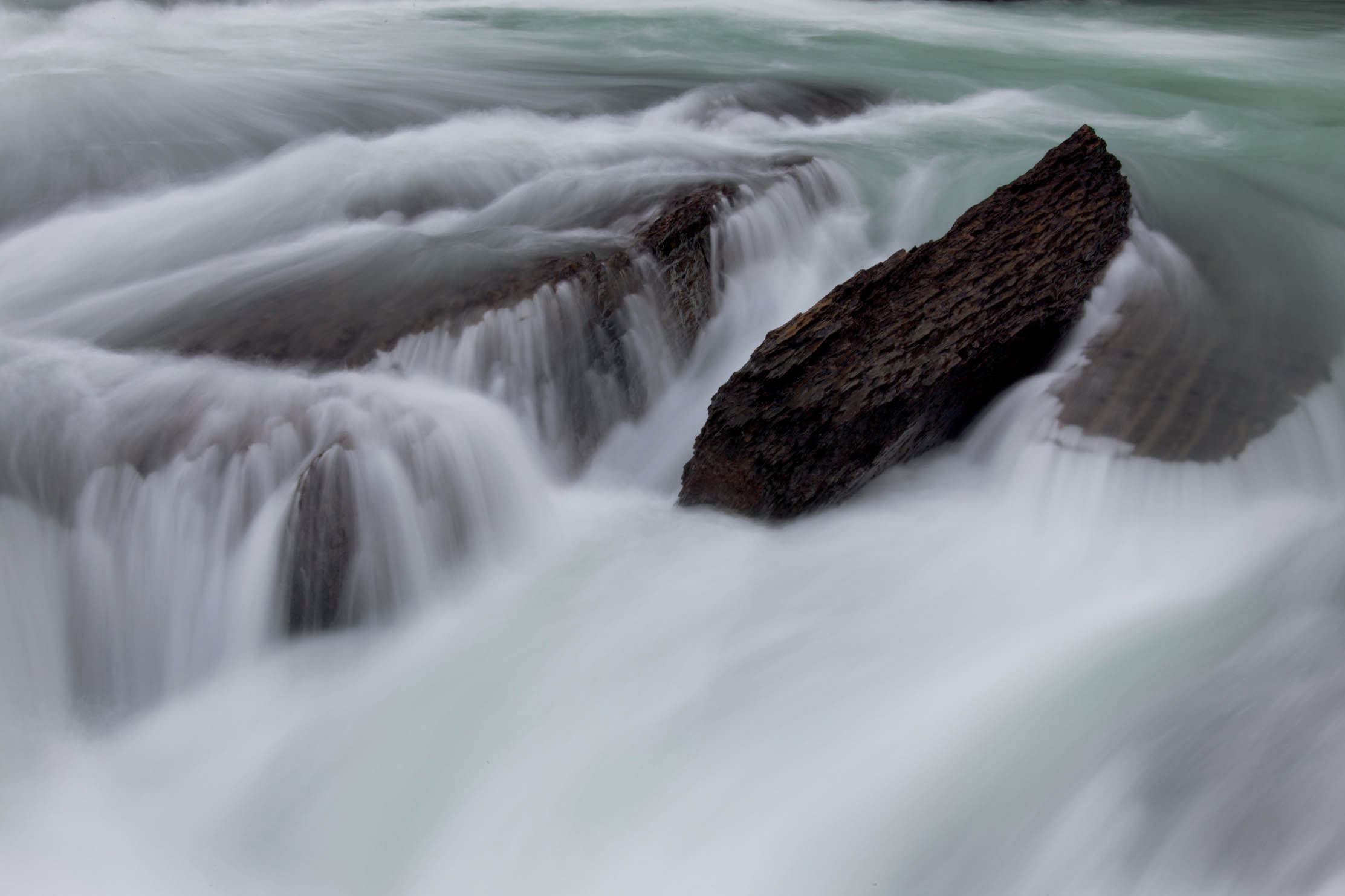 Capturing the flow of a river with a slow shutter speed (1s) was traditionally done out of necessity, but now is more of an artistic choice. 1 sec.; f/32; ISO 50; Canon 5D Mark II; EF70-200mm f/4L IS USM @ 78mm