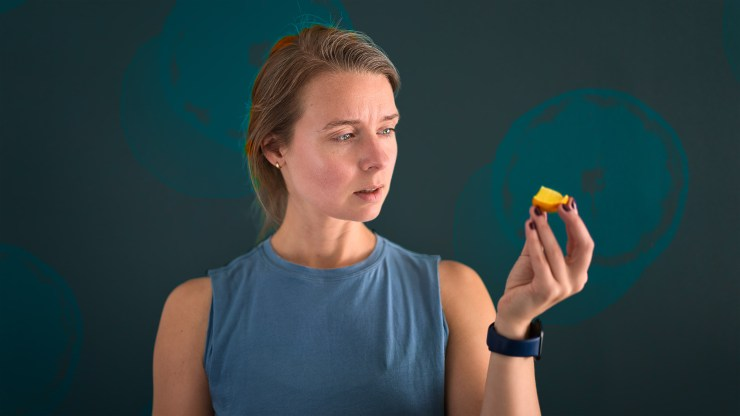 Female holding lemon quarter