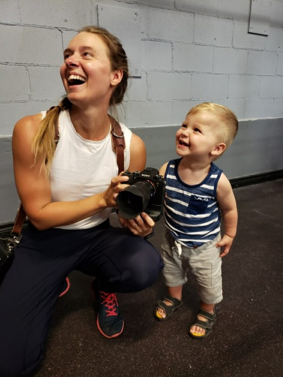 Female photographer with child