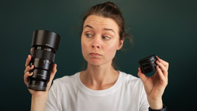 Female photographer holding macro lens extension tubes