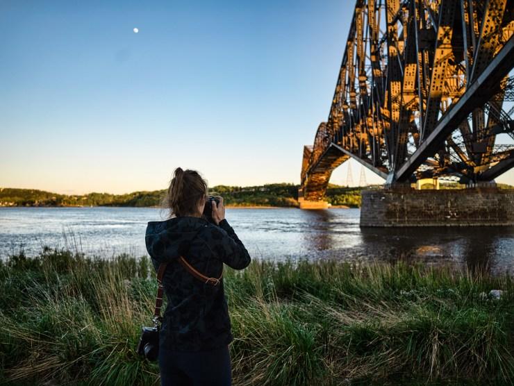 Wide angle lens bridge female photographer