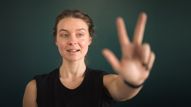 Woman blurred hand foreground