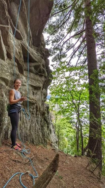 Female climber bottom rock wall