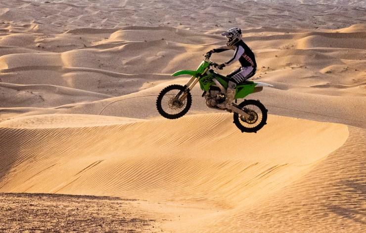 dirt bike photo jumping the desert dunes