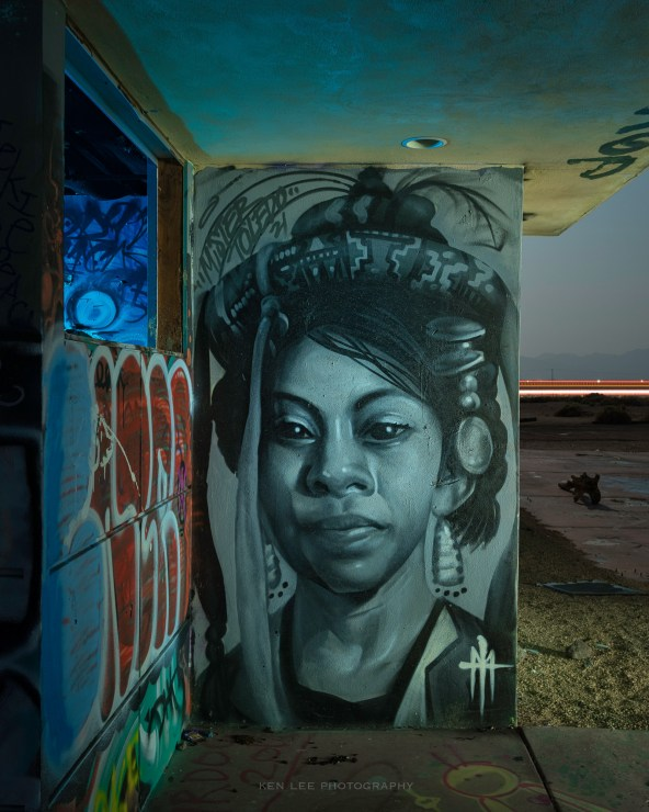 Generally speaking, I really dislike graffiti. That said, this particular painting of this woman captivated me, and I knew I had to photograph her at night later. I used a handheld ProtoMachines LED2, using warm white and blue light from numerous angles during the exposure, to create the lighting for this image.