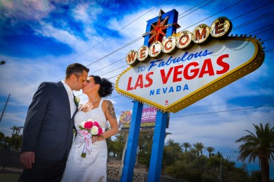 Photographers of Las Vegas - Vegas Strip Tour Photography - Wedding Bride and Groom at the Welcome to Las Vegas Sign