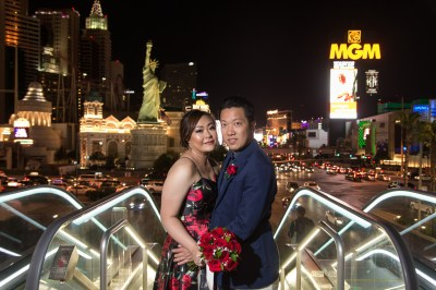 Photographers of Las Vegas - Wedding Photography - wedding couple on bridge with las vegas strip in the background