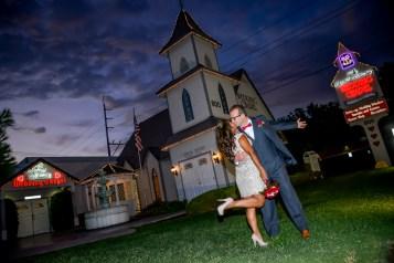 Photographers of Las Vegas - Wedding Photography - wedding couple celebration pose at twilight