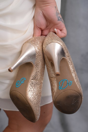 Photographers of Las Vegas - Wedding Photography - wedding bride holding I do shoes