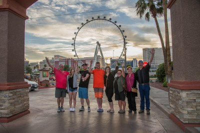 Photographers of Las Vegas - Portrait Photography - group photo at sunset with ferris wheel