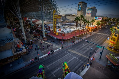 Photographers of Las Vegas - Architectural Photography - downtown las vegas Freemont street experience feet dangling off rooftop