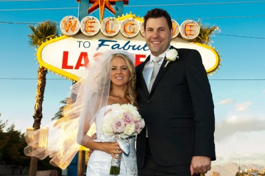Photographers of Las Vegas - Wedding Photography - wedding bride and groom in front of sign background removed