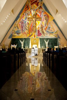 Photographers of Las Vegas - Wedding Photography - Couple kneeling at alter in Church
