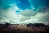 Late Summer Clouds thru car window