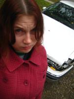 This is when my car was only hurt. Look how sad I was. I was much more sad when my car finally died. Rest in peace, Dr. Gonzo!