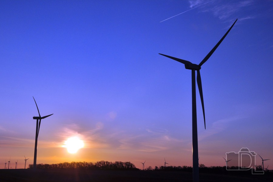 The sun rises at a wind farm near Toronto, South Dakota.