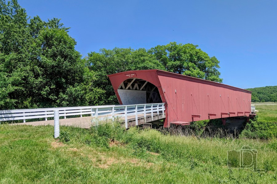 The Hogback Covered Bridge, one of six remaining covered bridges in Madison County, Iowa, sits peacefully on a summer day near the town of Winterset.
