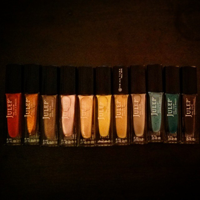 a photo of eleven different coloured nail polishes