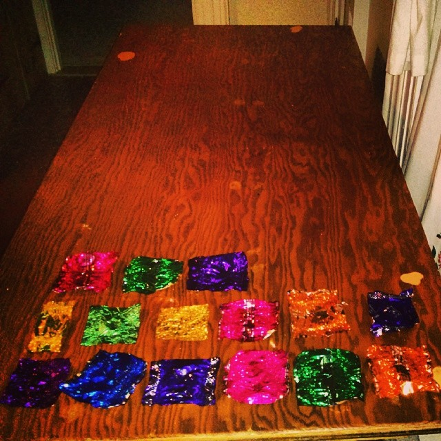 a photo of fifteen chocolate wrappers on a table